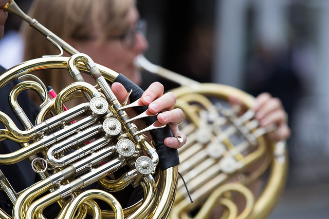 the french horn section rehearsing