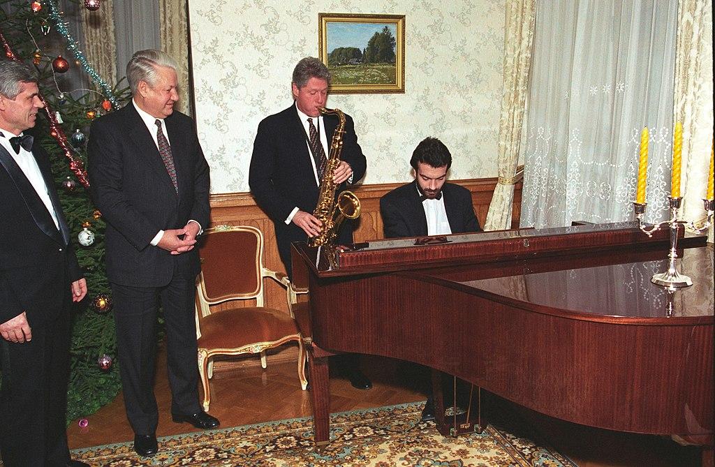 Bill Clinton playing the saxophone